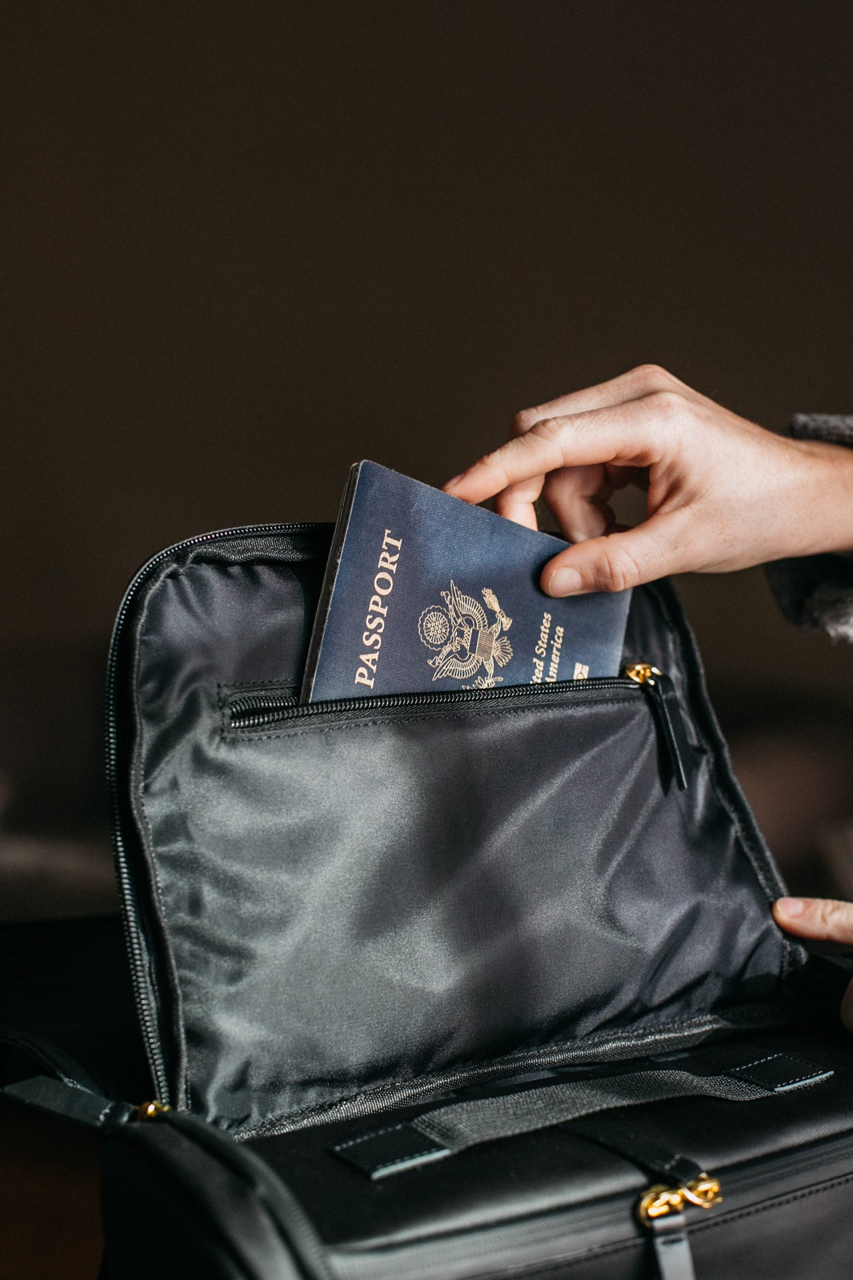 https://www.mynotarychichester.co.uk/wp-content/uploads/2020/06/person-putting-a-passport-on-bag-842961-scaled.jpg